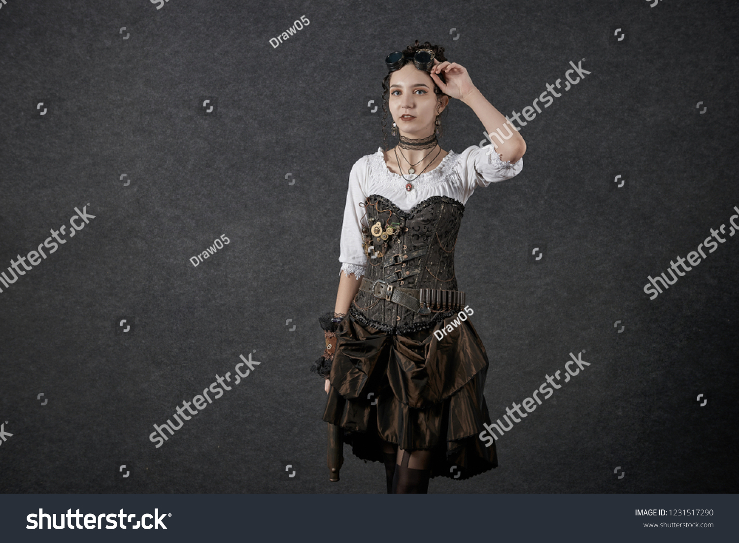 Cosplayer young woman dressed steampunk style shoot on black background in  photo zone - Image