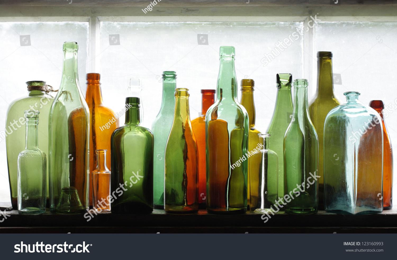 Old Glass Bottles Part - 44: Many Old Glass Bottles On Windowsill. Closeup, Daylight.