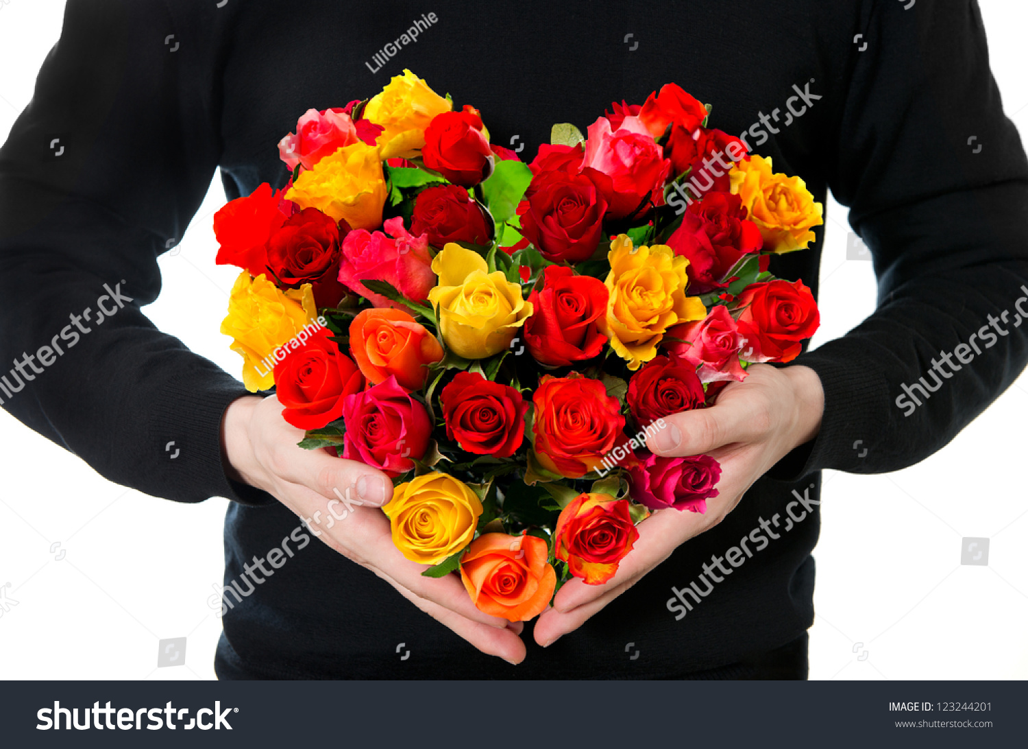 Red roses mans hands colorful flowers stock photo royalty free red roses mans hands with colorful flowers bouquet in heart shape izmirmasajfo