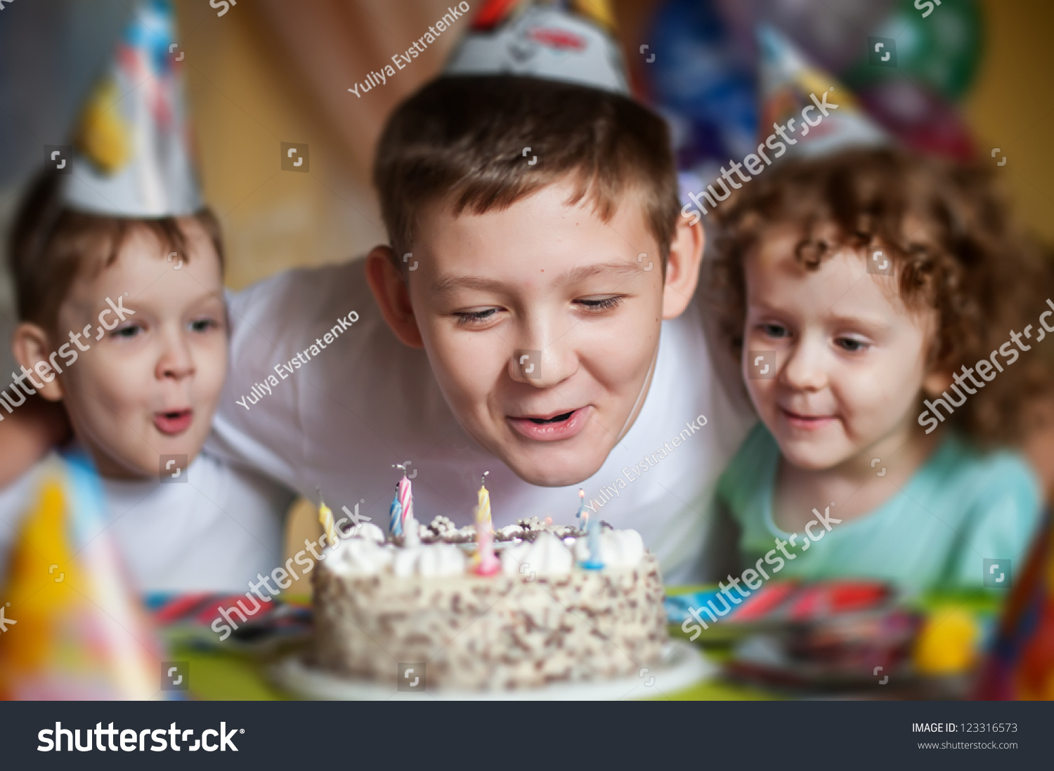 Boy Blows Out Candles On Birthday Stock Photo (Edit Now