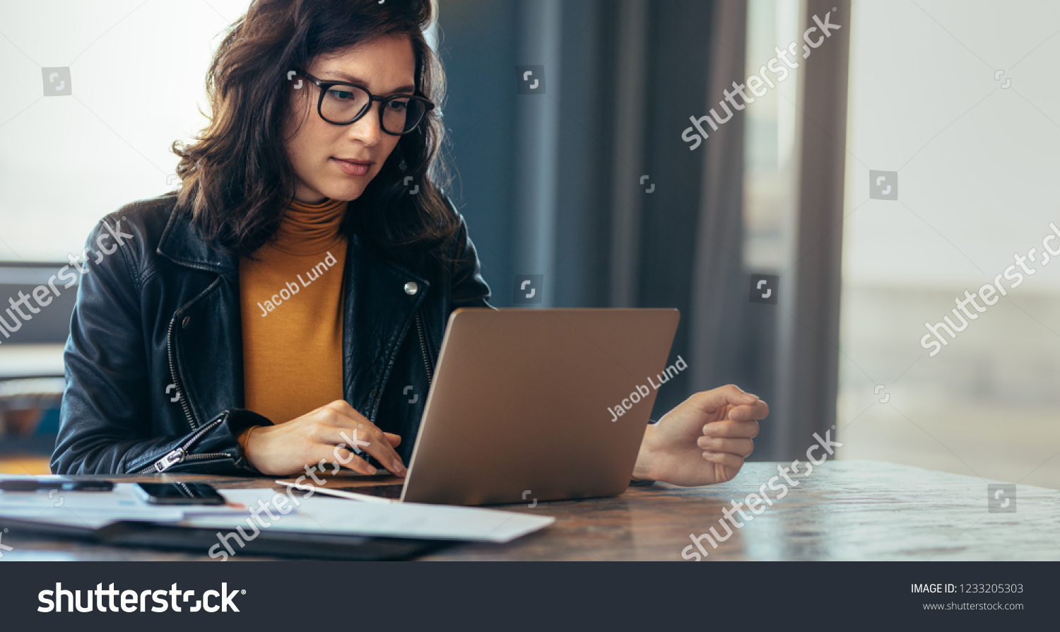 Asian woman working laptop. Business woman busy working on laptop computer at office. #1233205303
