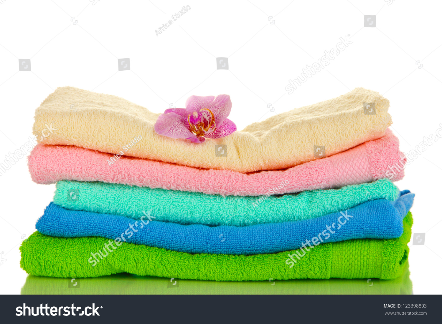 Stack Of Towels With Fragrant Flower Isolated On White ...