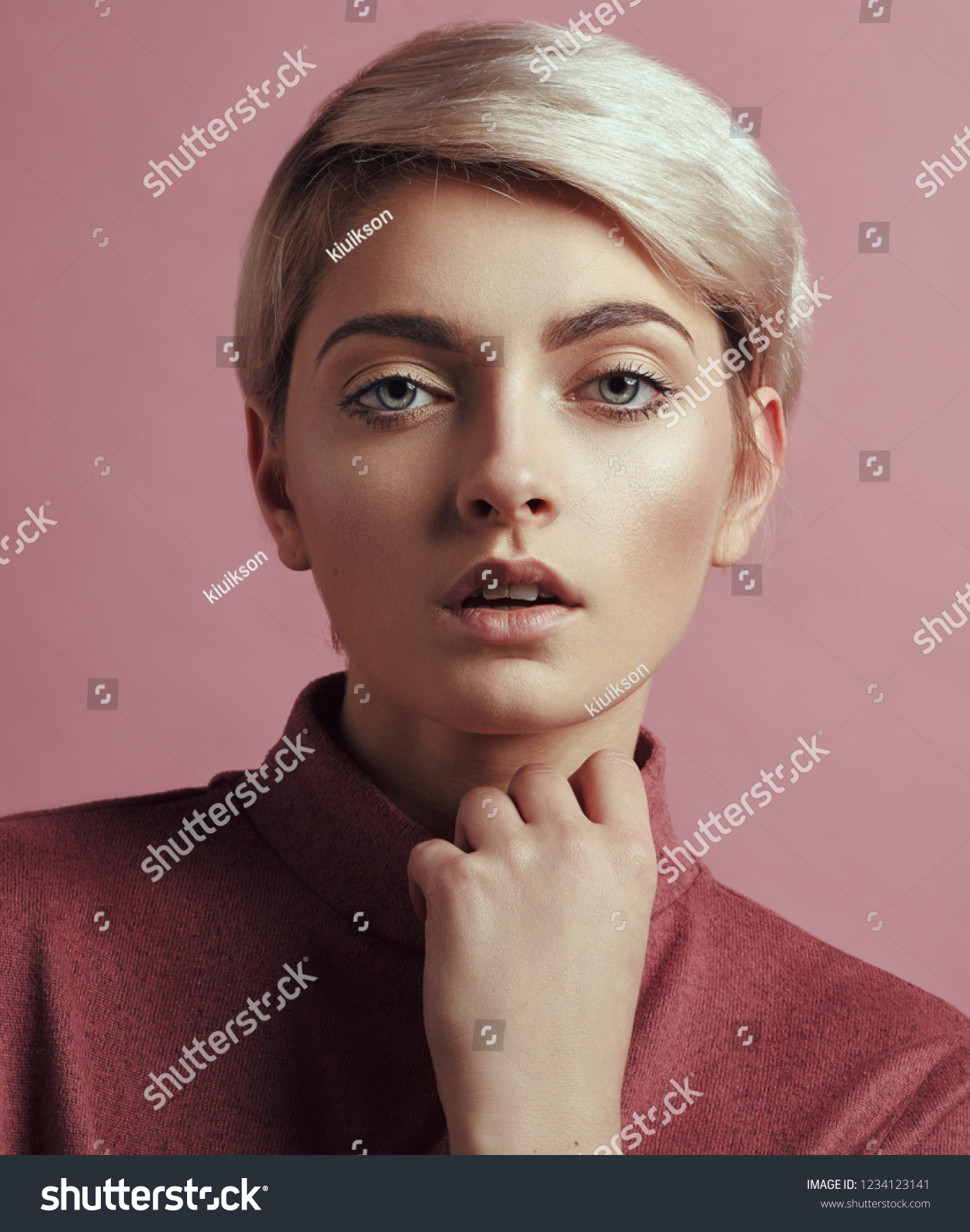 Portrait of fashion woman with blond short hair isolated on pink background #1234123141