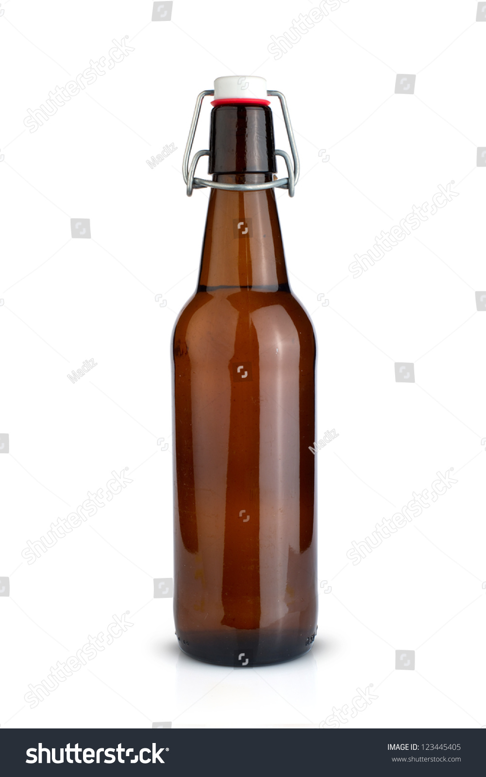 Old brown bottle of beer isolated on white stock photo 123445405