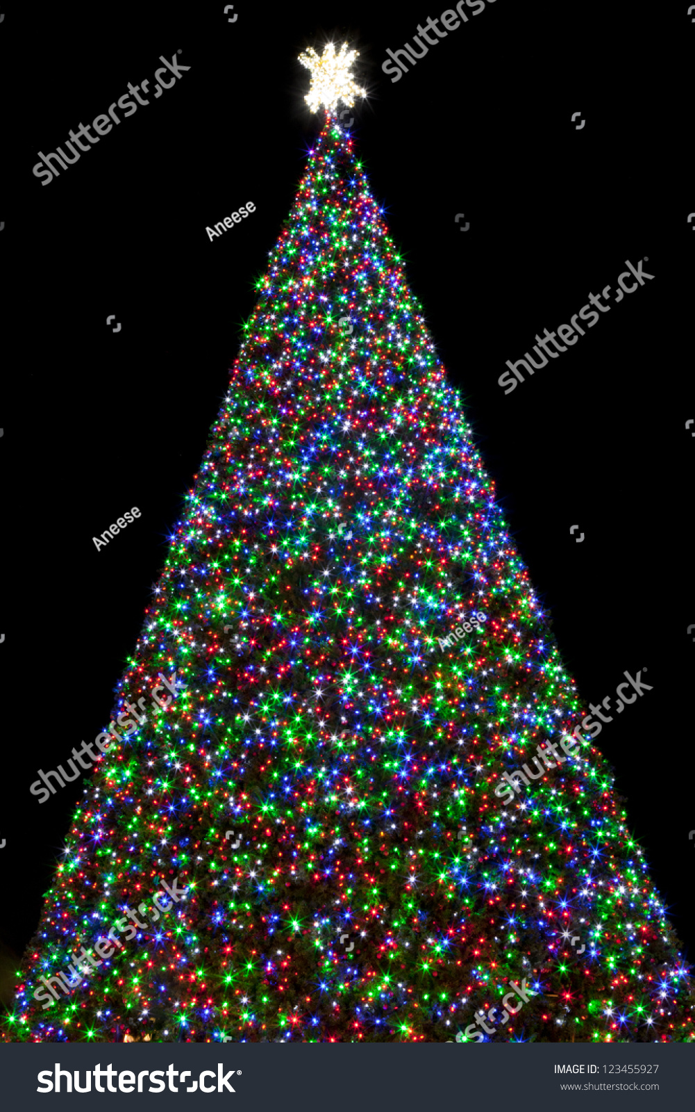 100 ft christmas tree covered with red green and blue lights at night - Christmas Tree With Blue Lights