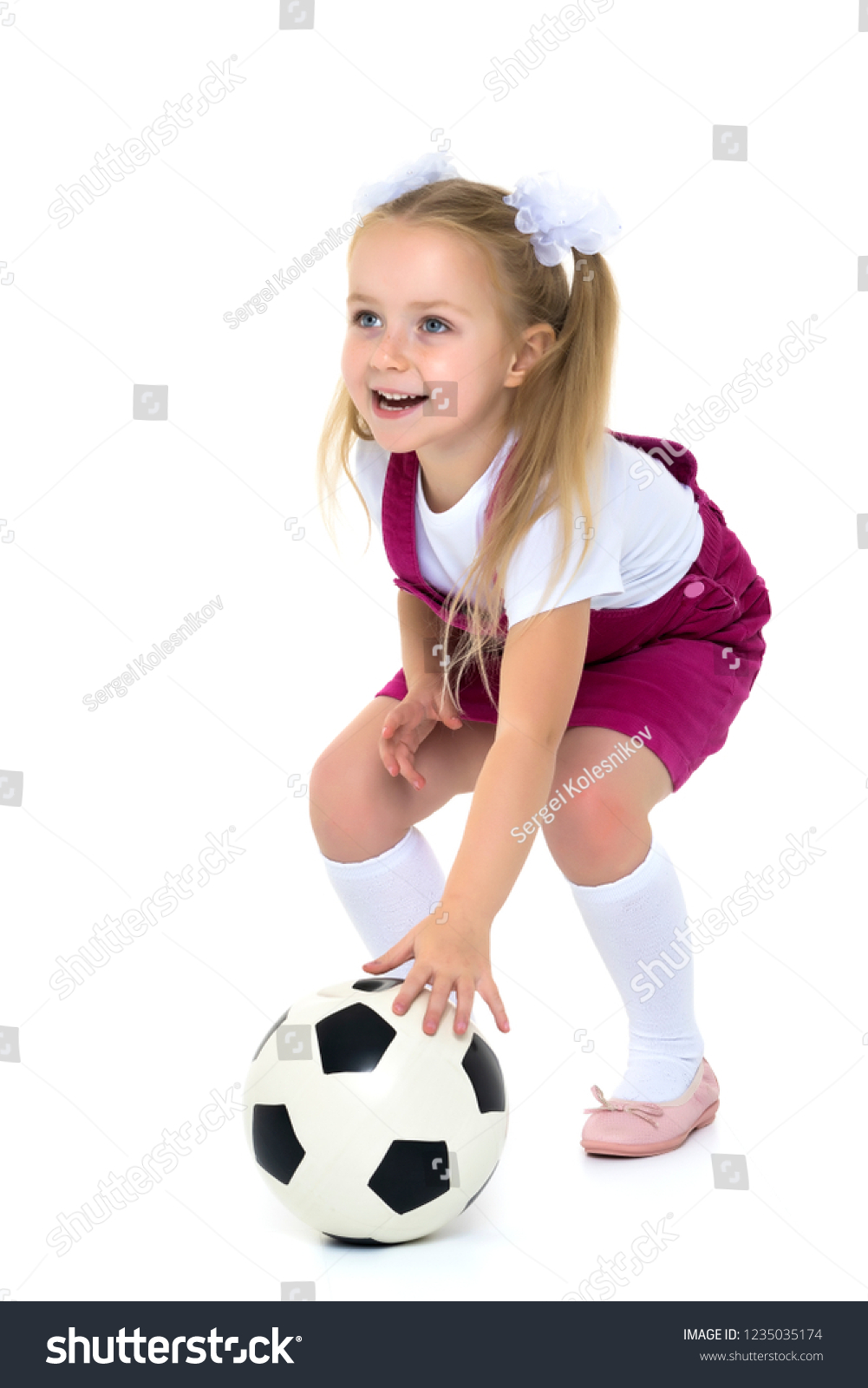 75fef3b31 Adorable little girl with a soccer ball. The concept of children s sports