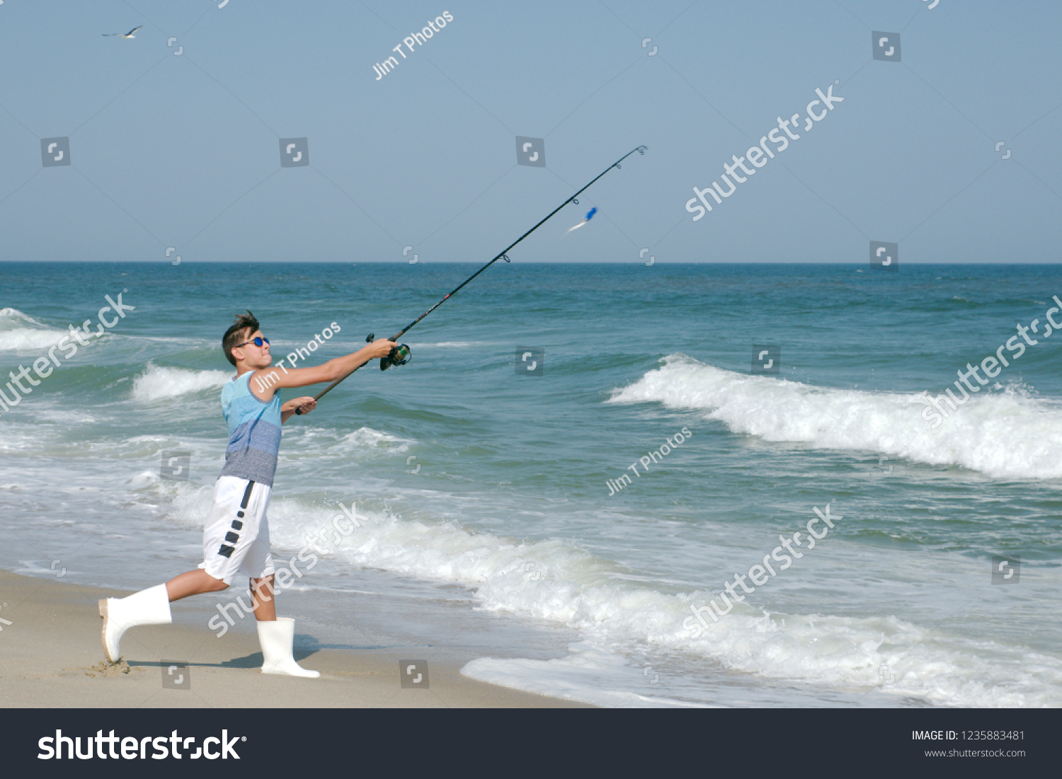 Young Boy Surf Fishing Off Sandy Stock Photo Edit Now 1235883481