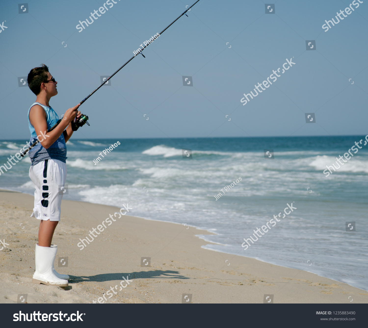 Young Boy Surf Fishing Off Sandy Stock Photo Edit Now 1235883490