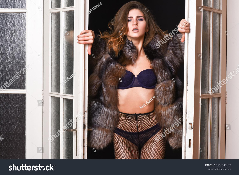 318dcb811a4 Woman seductive wear luxury fur and lingerie. Seduction art concept. Female  lover enter bedroom doors. Fashion lady confident and seductive.