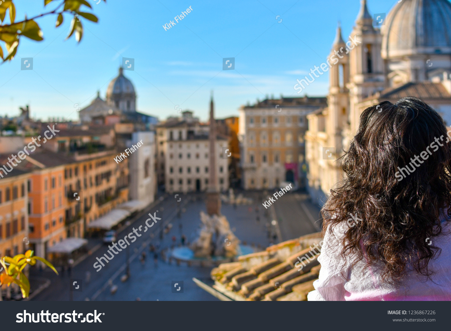 stock-photo-a-young-woman-gazes-out-over