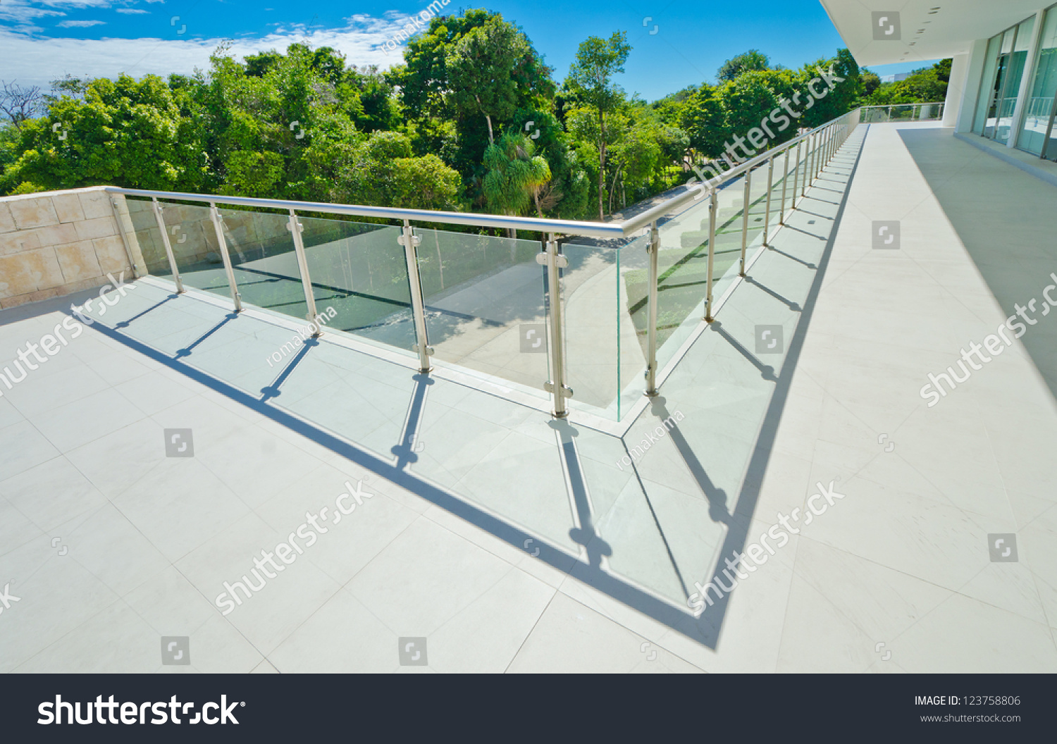Perspective modern glass steel balcony deck stock photo for Exterior balcony railing design