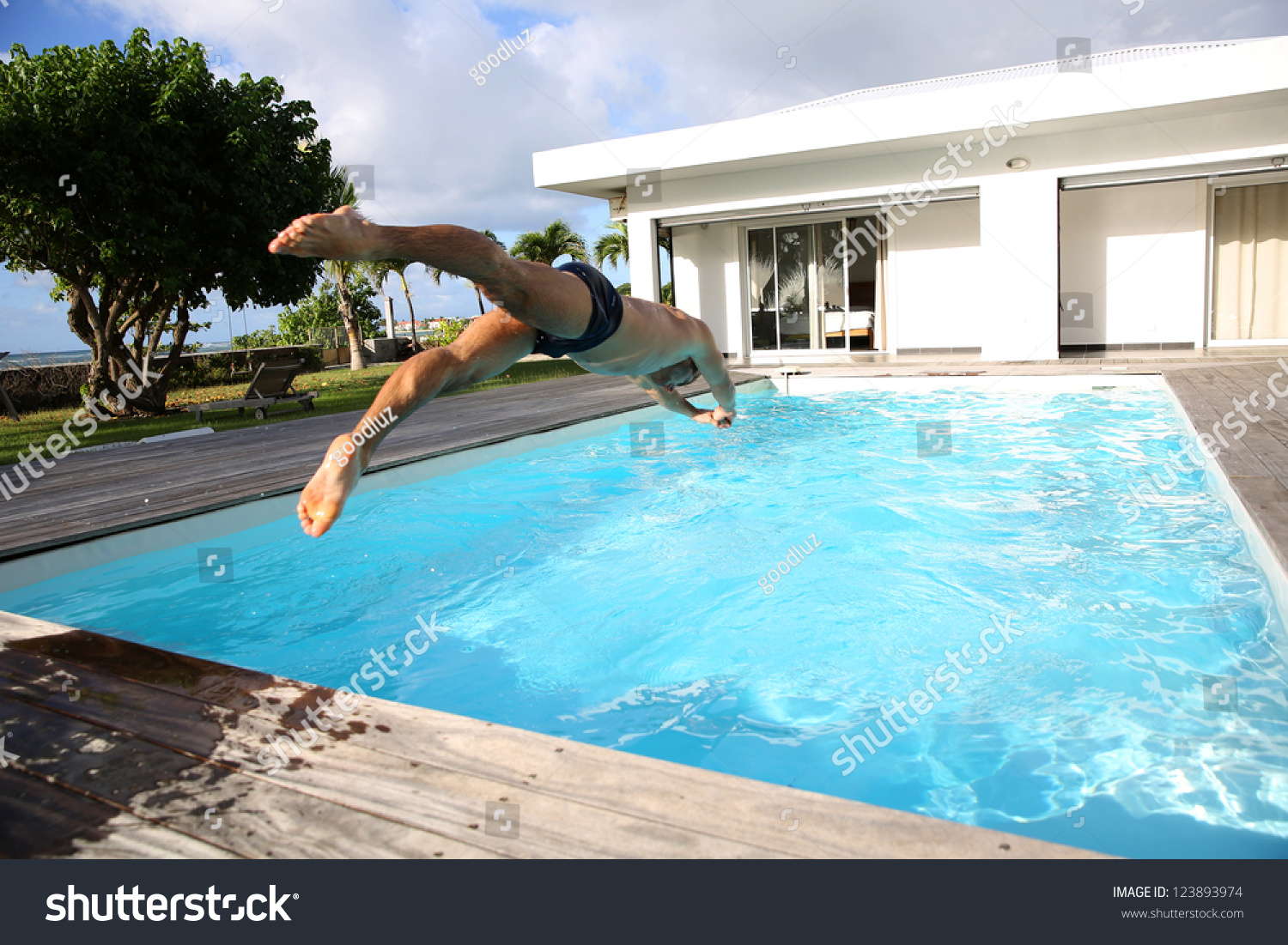 Man diving private swimmingpool stock photo 123893974 for Private swimming pool