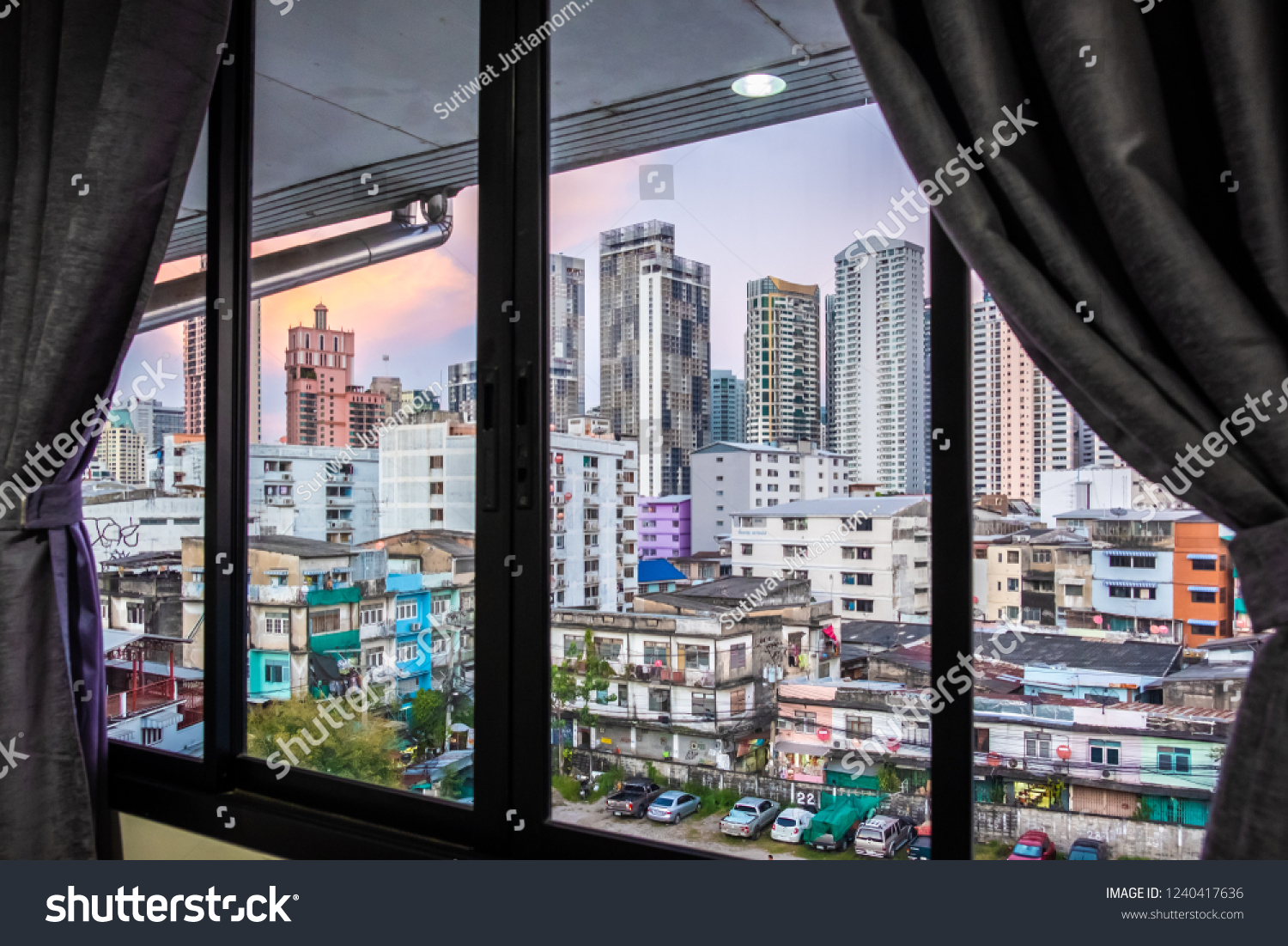 Interior space of modern empty office with city background. Window view of Manhattan city in Bangkok. Urban Scene Skyline night view metropolis concept. Detailed of the window view building hostel. #1240417636