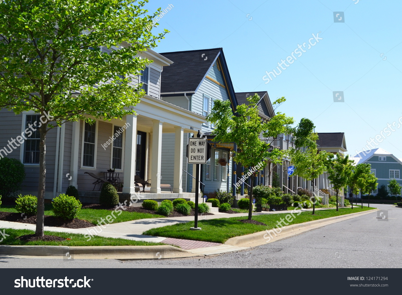 Suburban neighborhood new england style american stock for American dream home builders