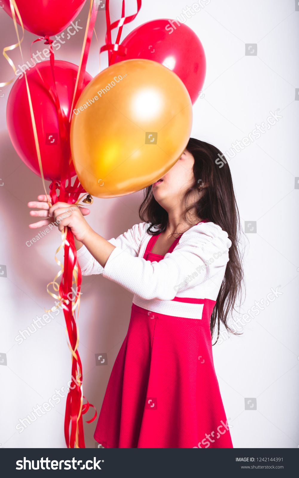 Baby Girl Holding Balloons Celebrating Her Birthday
