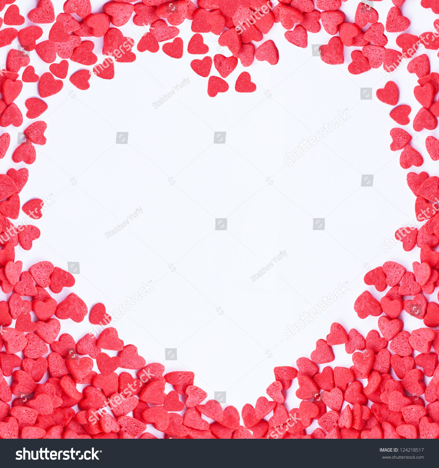 heart frame made of small red hearts on the white background