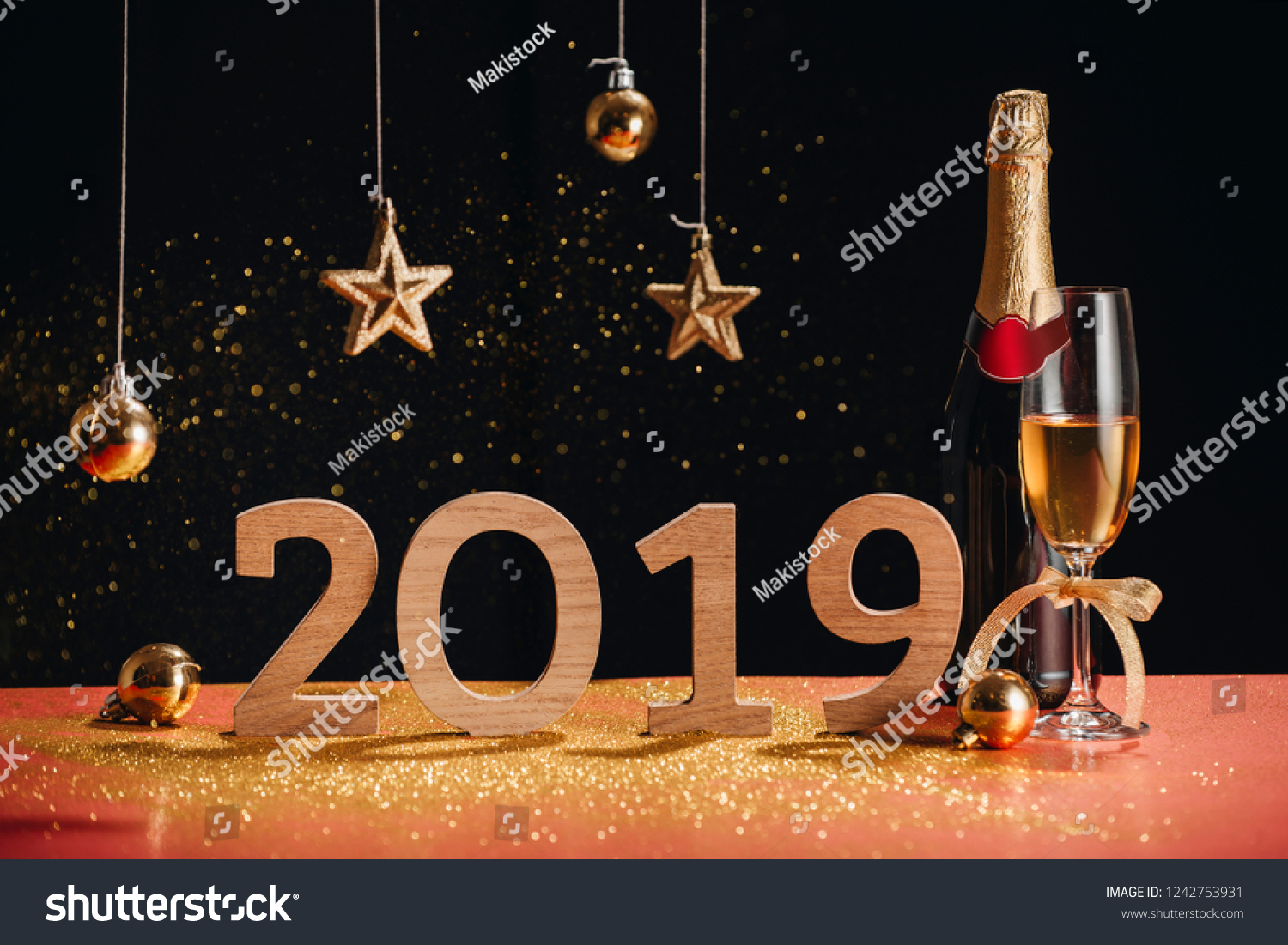 "Sparkling New Year background, copy space. Champagne with decorations on New Year""s Day #1242753931"