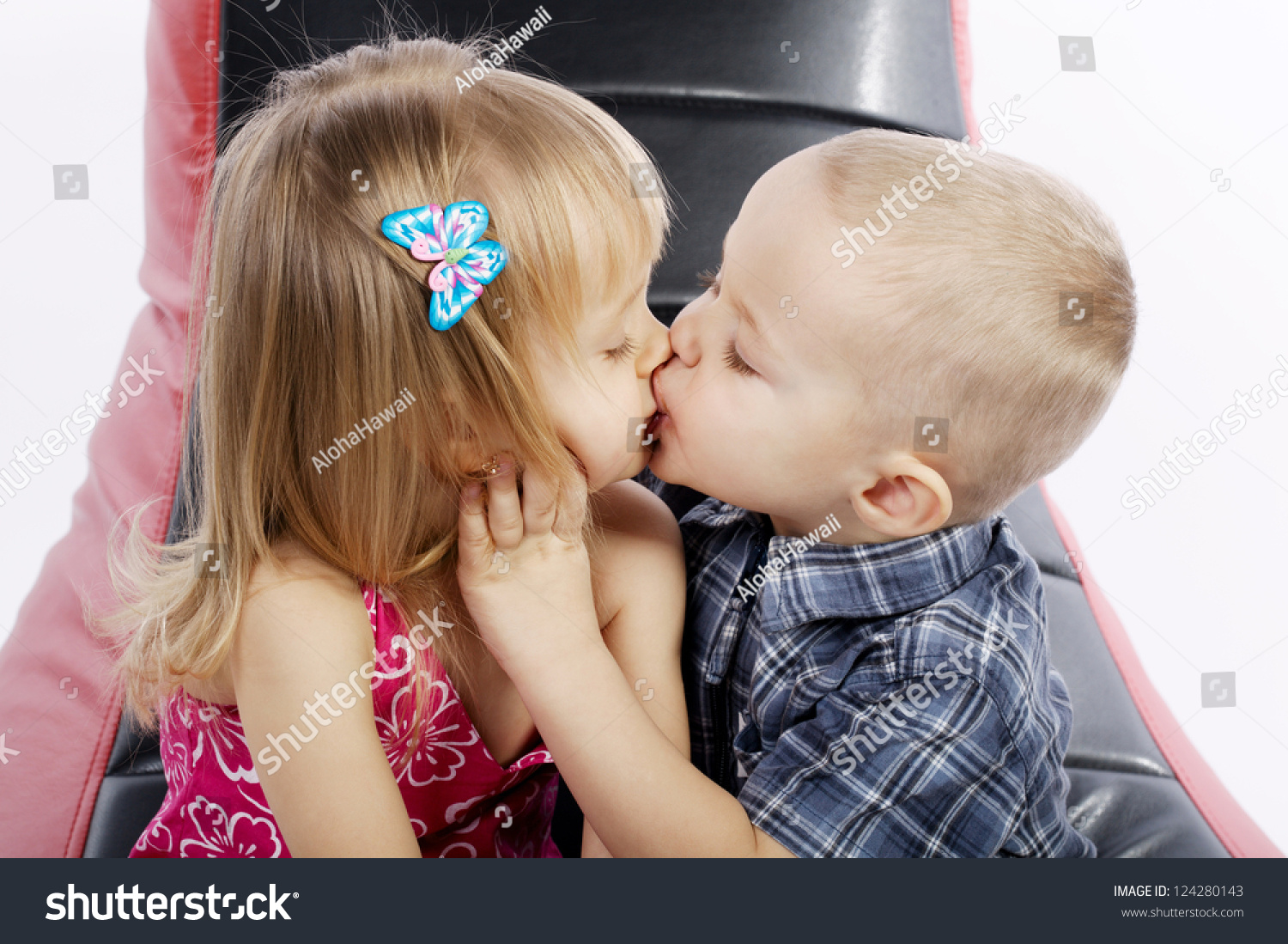 cute boy girl kissing passionately stock photo (royalty free