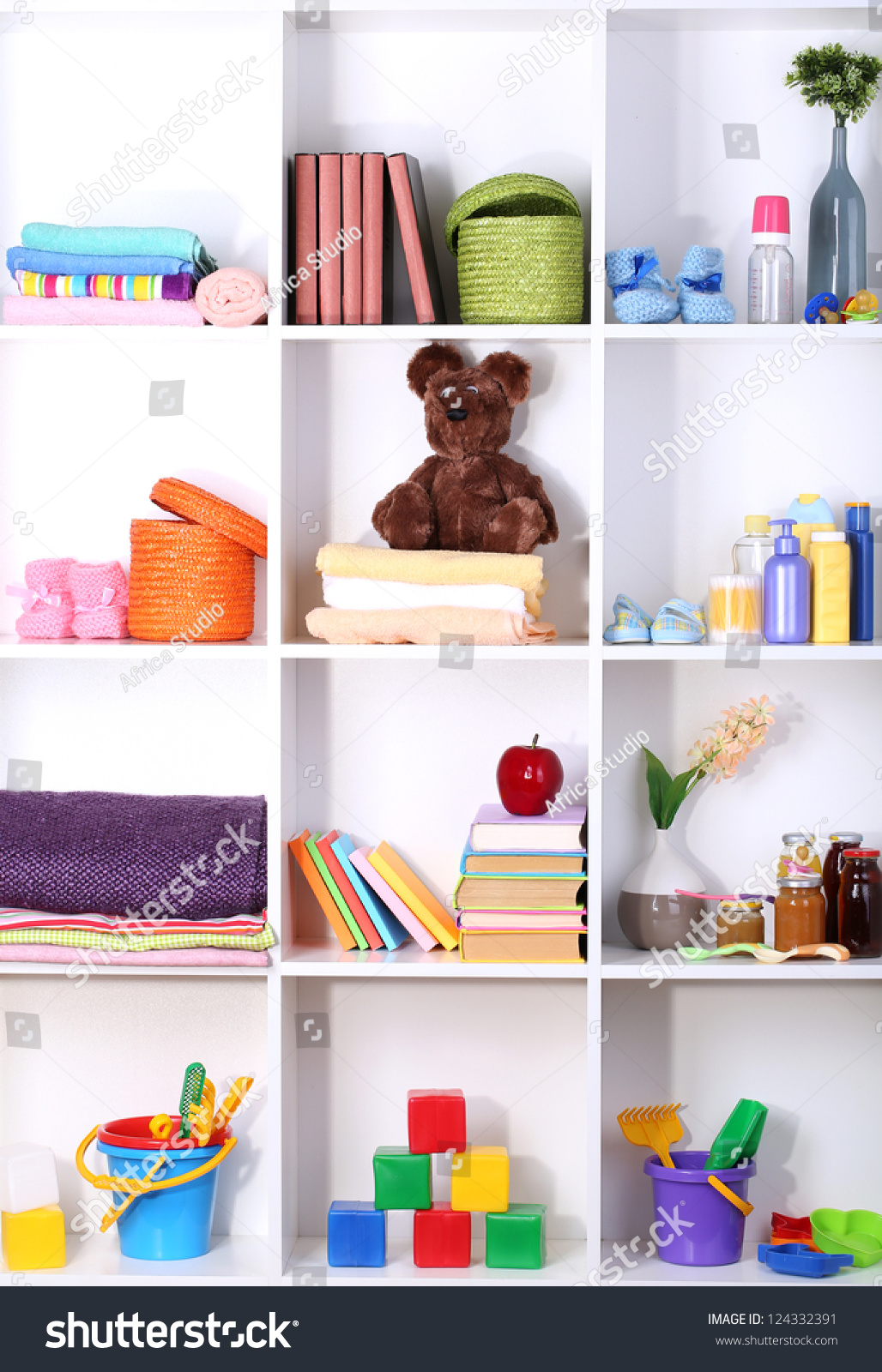 Beautiful white shelves with different baby related for Beautiful shelves images