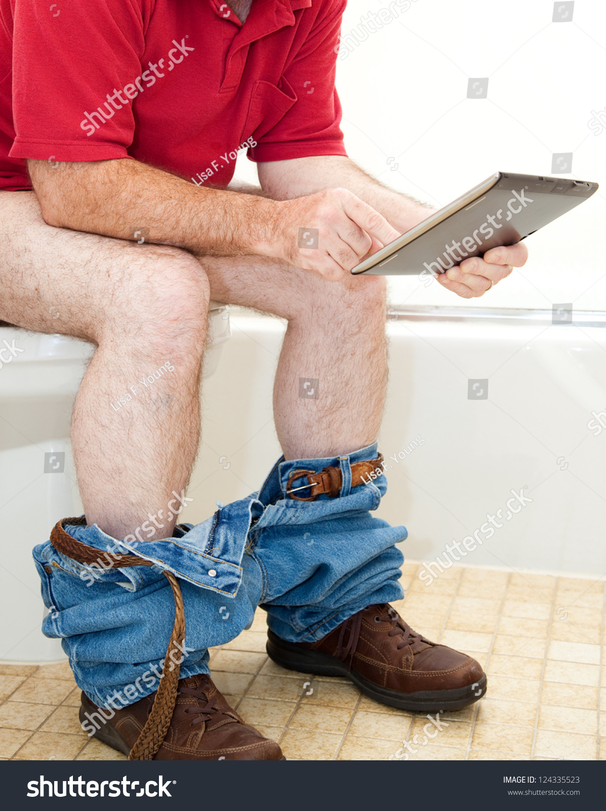 Young Man Sitting On Toilet Bowl Stock Photo - Image of