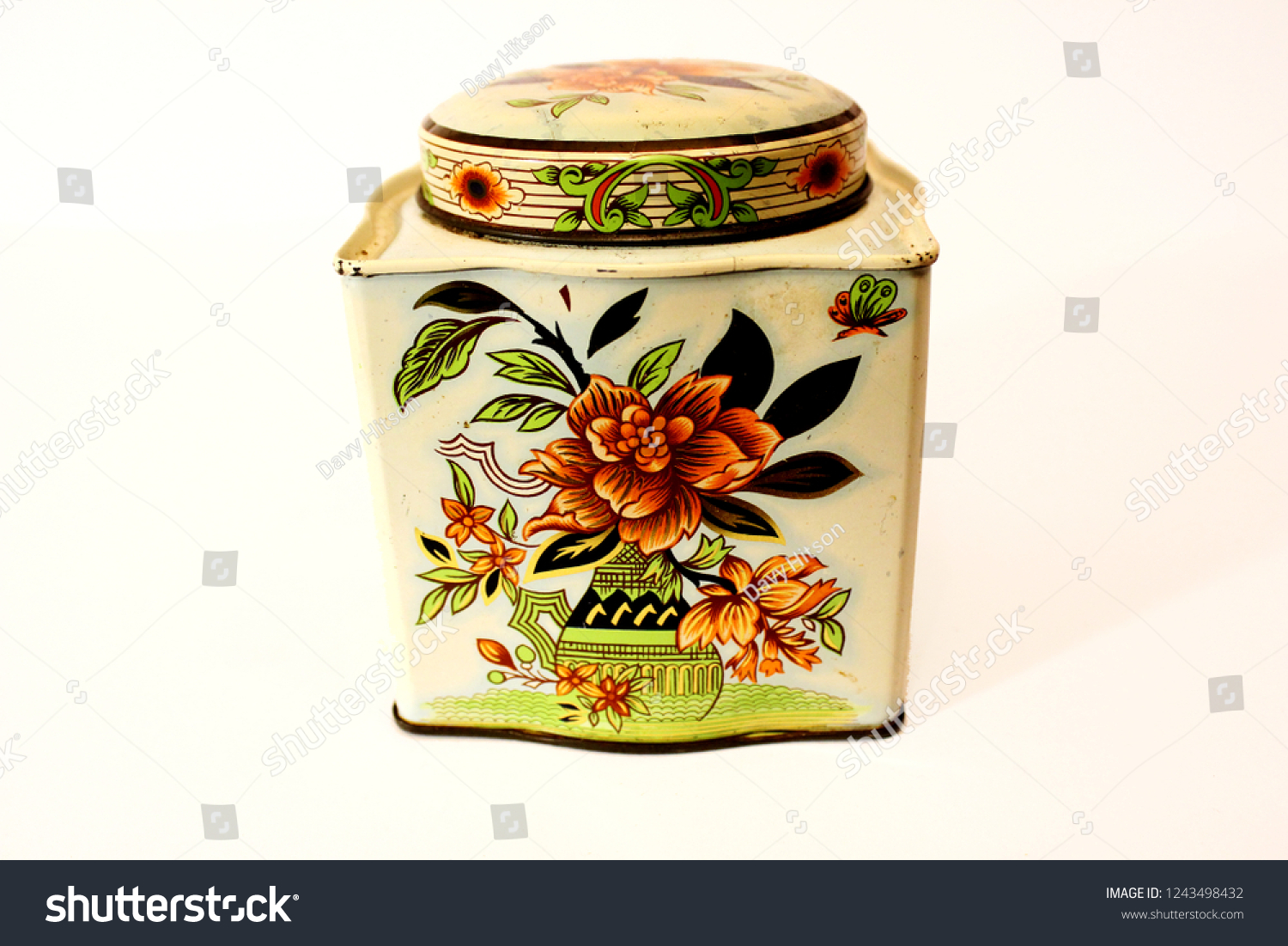 Vintage egg shell pantry tin container with decorative and vibrant floral  pattern.