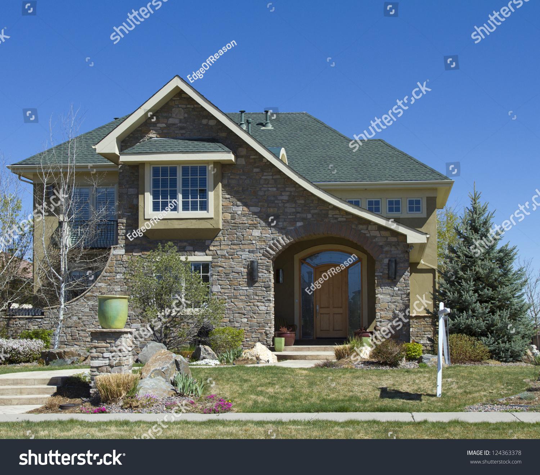 Luxury Brick Homes: Luxury Brick Home Beneath Blue Sky. Stock Photo 124363378