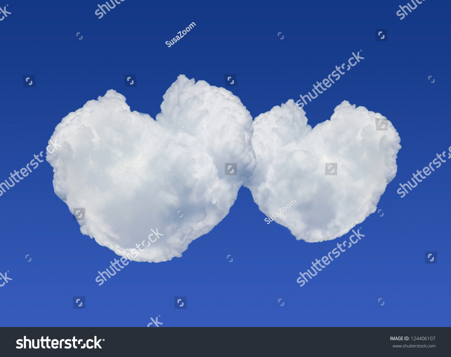 Fluffy Heart Shaped Clouds On Deep Blue Sky Background Stock Photo ...