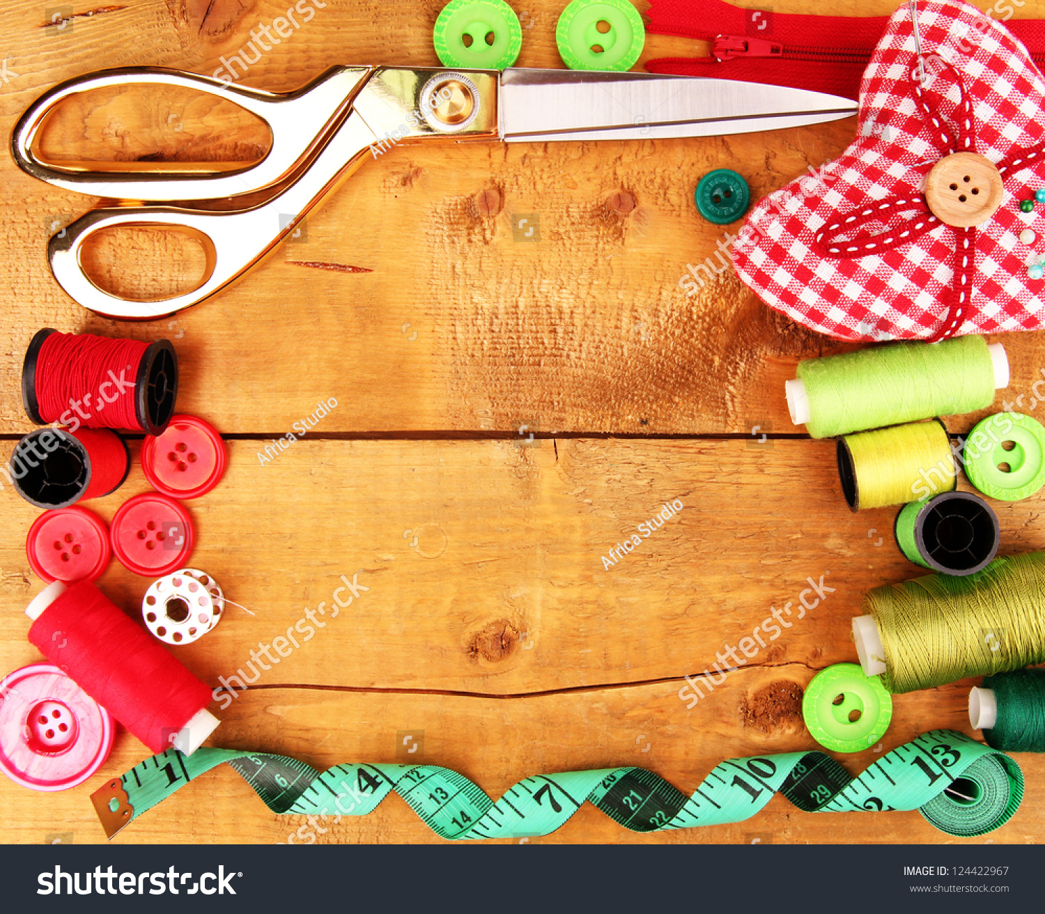 Sewing accessories and fabric on wooden table close up