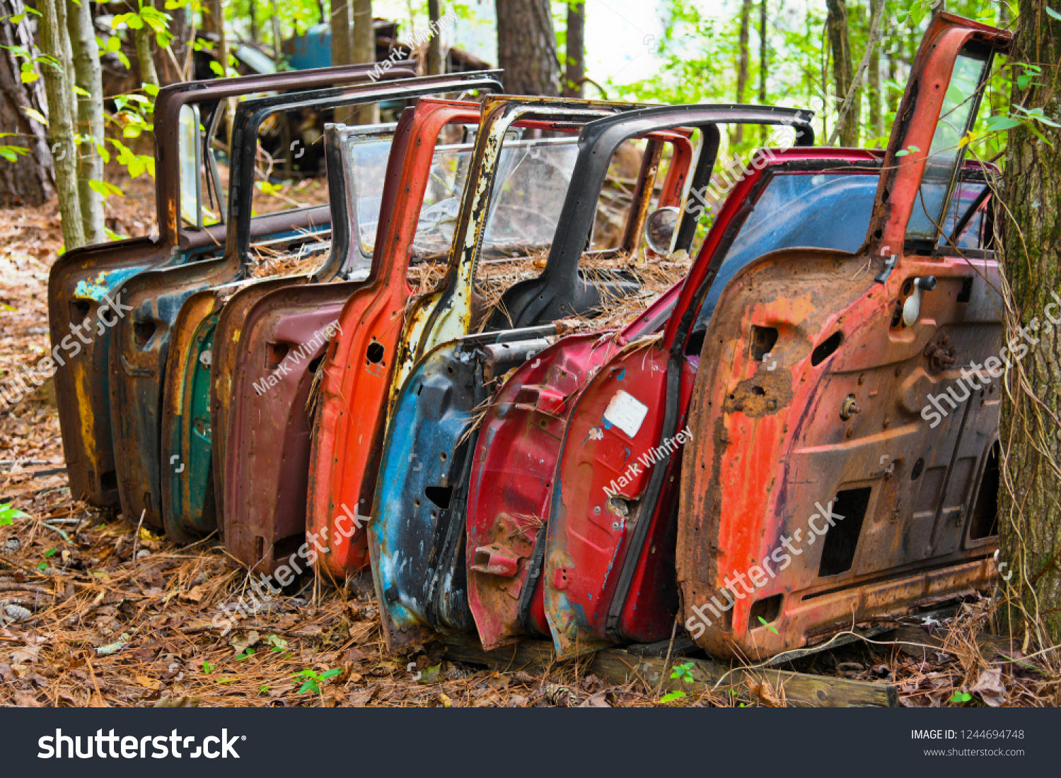 stock-photo-a-row-of-old-doors-off-scrap
