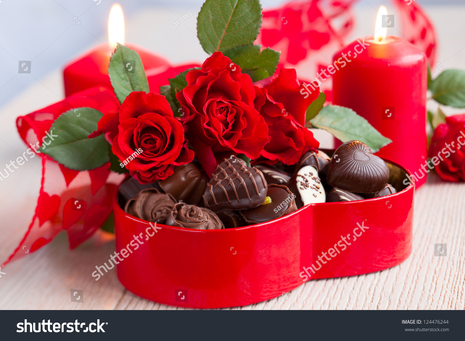 red roses chocolate candies valentines day stock photo