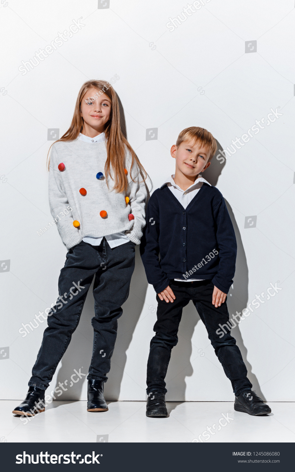 8ac37533a The portrait of cute little kids boy and girl in stylish jeans clothes  looking at camera