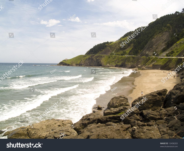 Rocks In Spanish Part - 30: Coast Line In Spanish Deba City. Rocks Water And Blue Sky