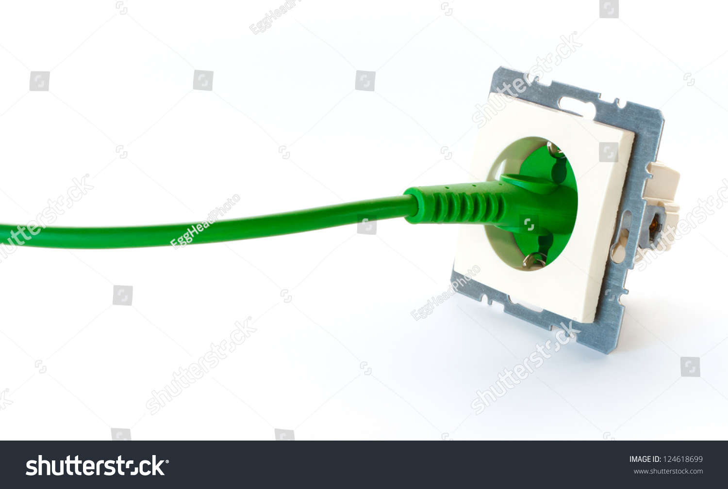 Green Power Cable : Green power cable plugged into wall outlet without cover