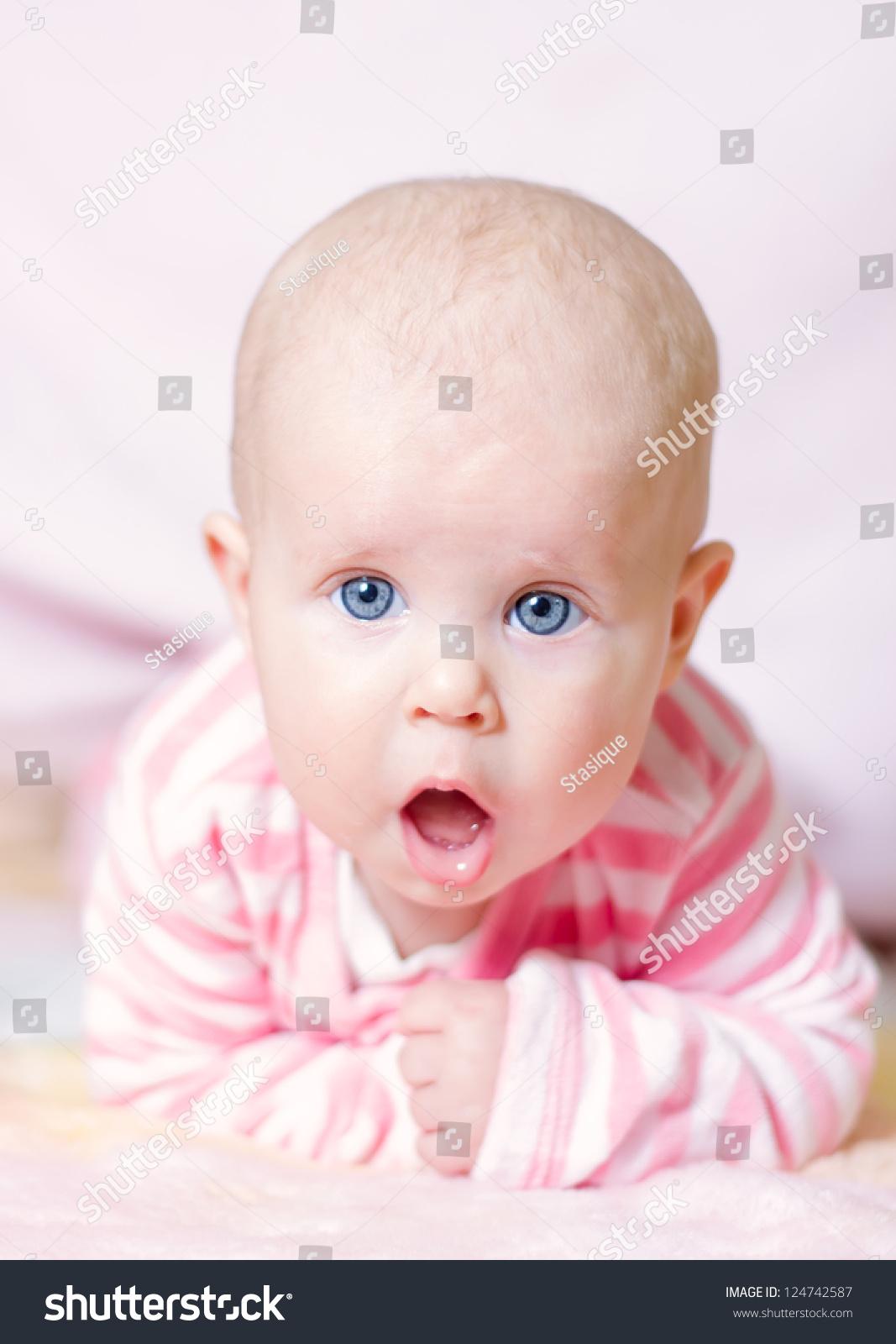 cute baby girl with big blue eyes lying down | ez canvas