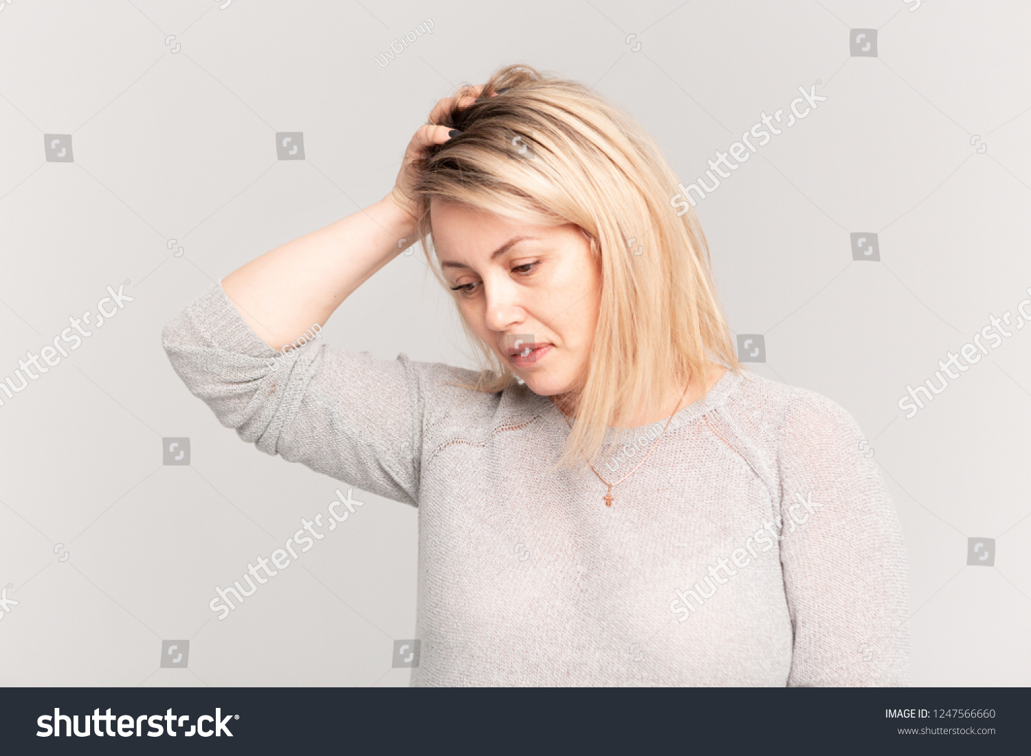 Portrait of middle aged adult woman feeling head ache, pain or high blood  pressure facial