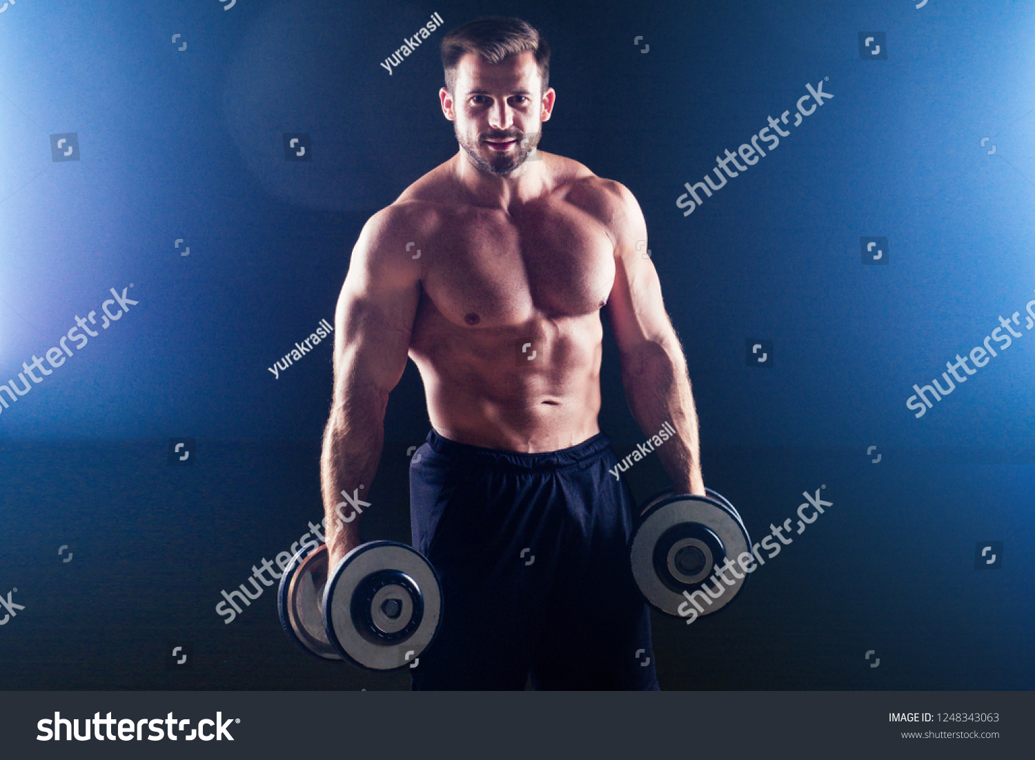 Muscular bodybuilder male fitness model perfect muscles six pack abs and  bare nude chest doing exercises