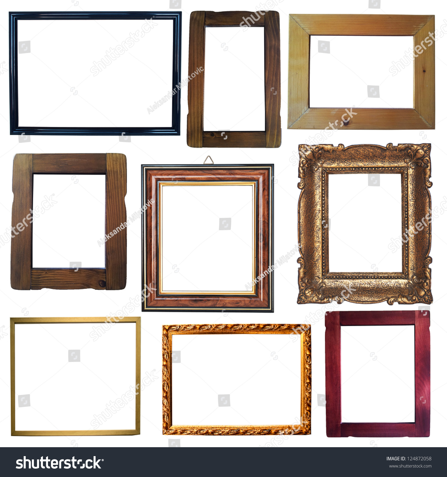 collection of vintage wooden and golden empty frames isolated on white background