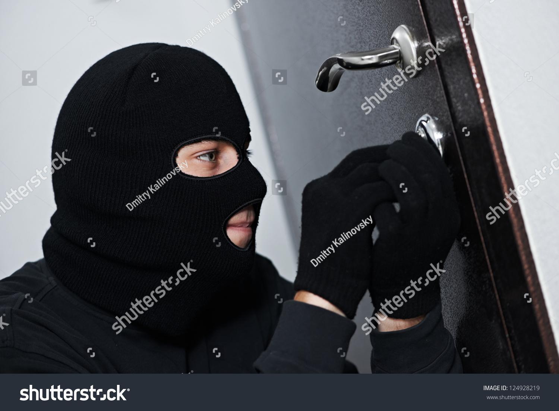Thief Burglar force lock metal door with a tool during house breaking & Thief Burglar Force Lock Metal Door Stock Photo 124928219 ... Pezcame.Com