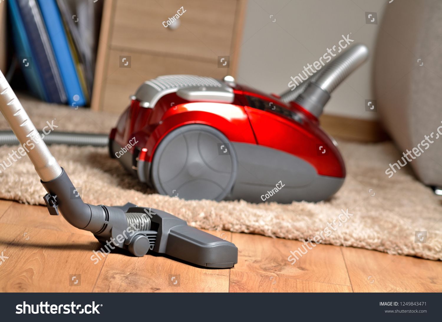 Vacuum Cleaner On Floating Floor Shaggy Stock Photo Edit Now
