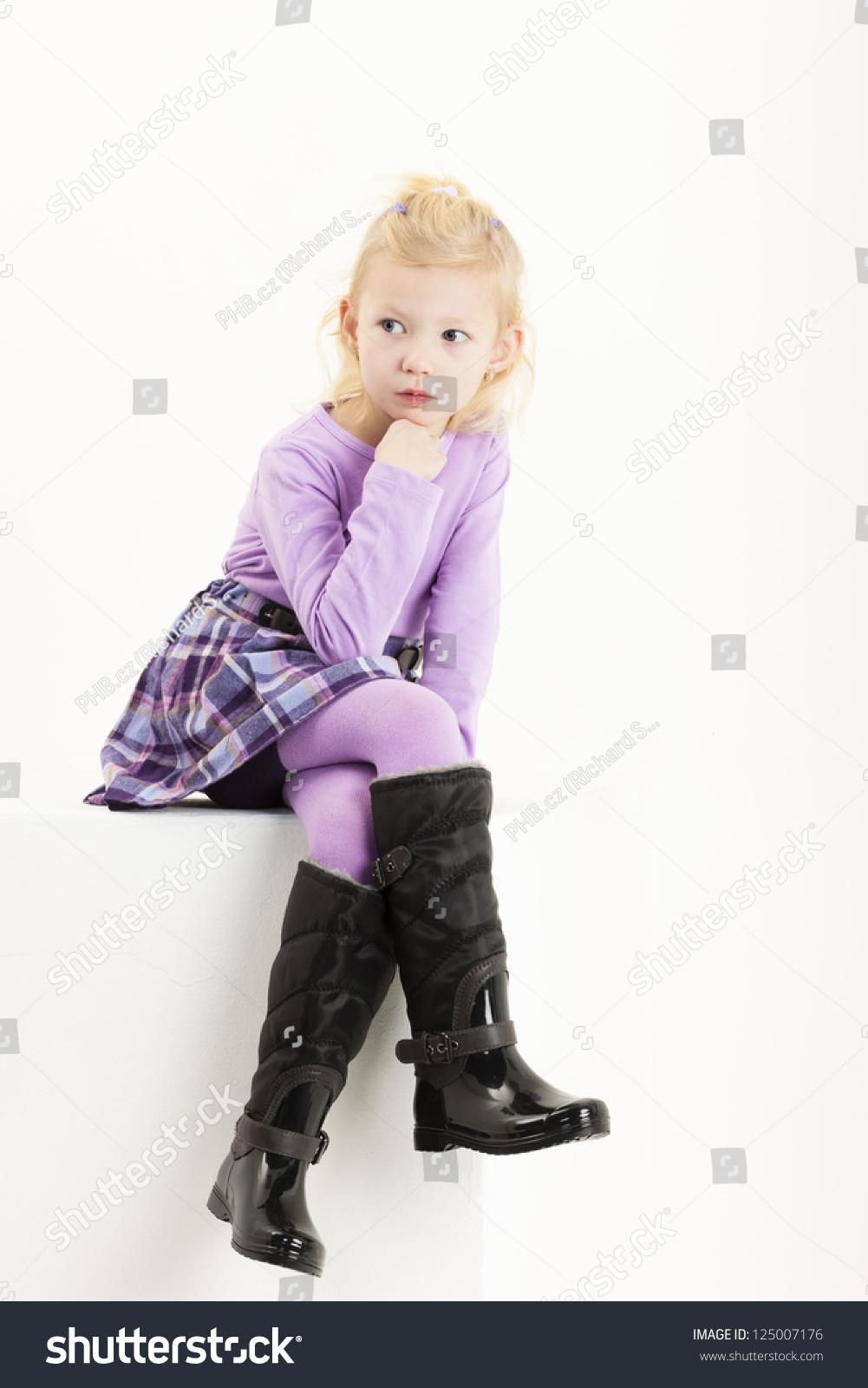 sitting little girl wearing a skirt stock photo 125007176