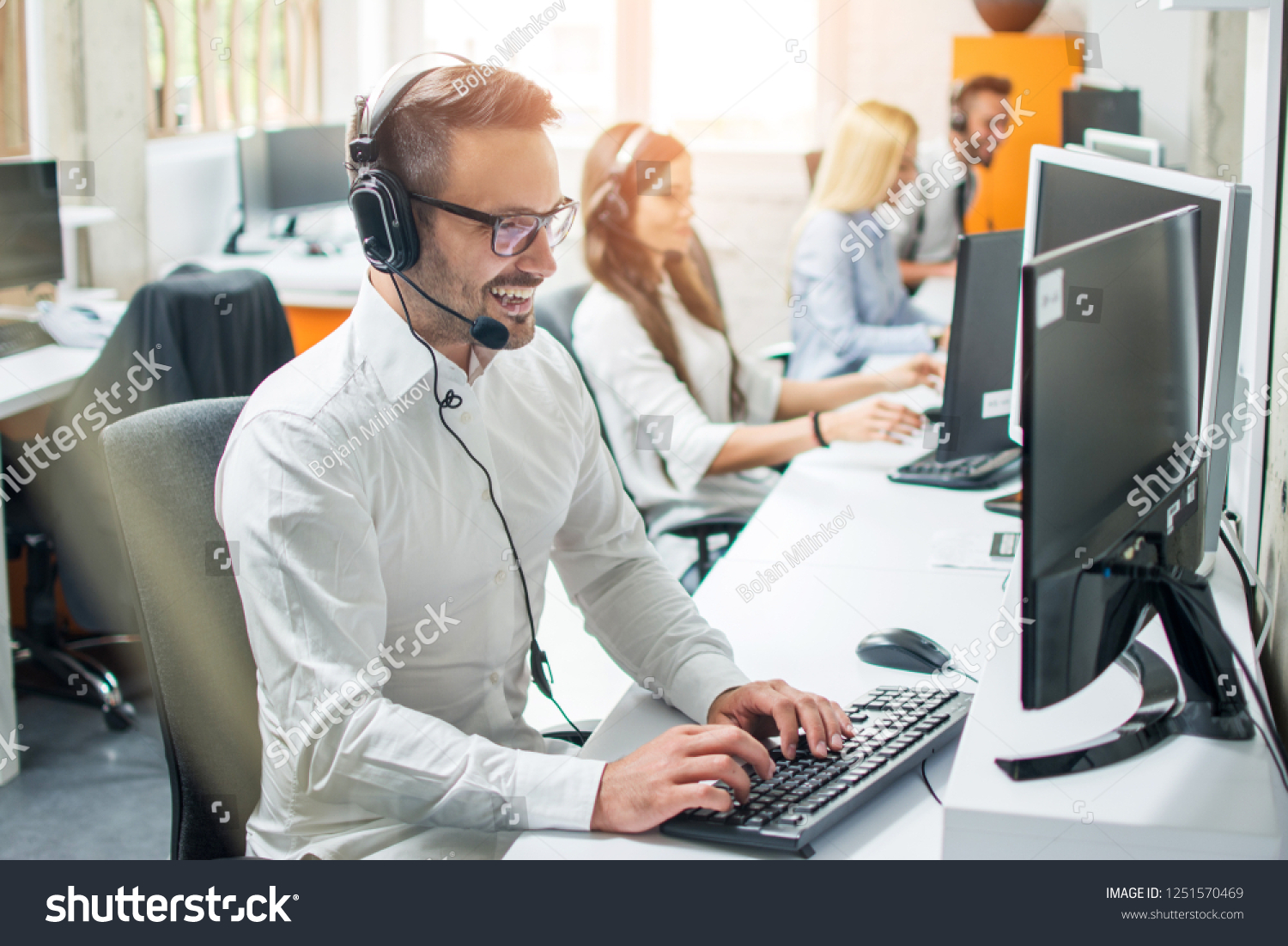 Young male technical support dispatcher in call center #1251570469