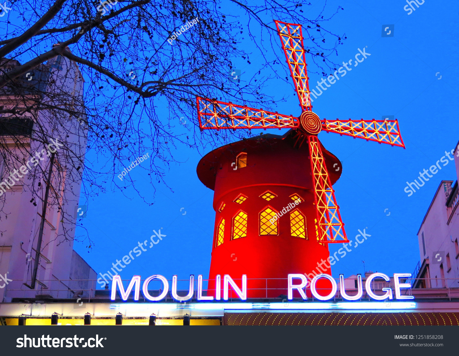 PARIS The Moulin Rouge on  blue hour 20.02.2016. in Paris, France. Picturesque Old facade building of famous cabaret built in 1889, locating in the Paris red-light district Pigalle