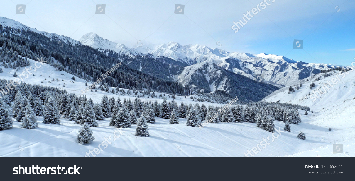 Panorama of winter mountains in Northern Tien Shan after snowfall