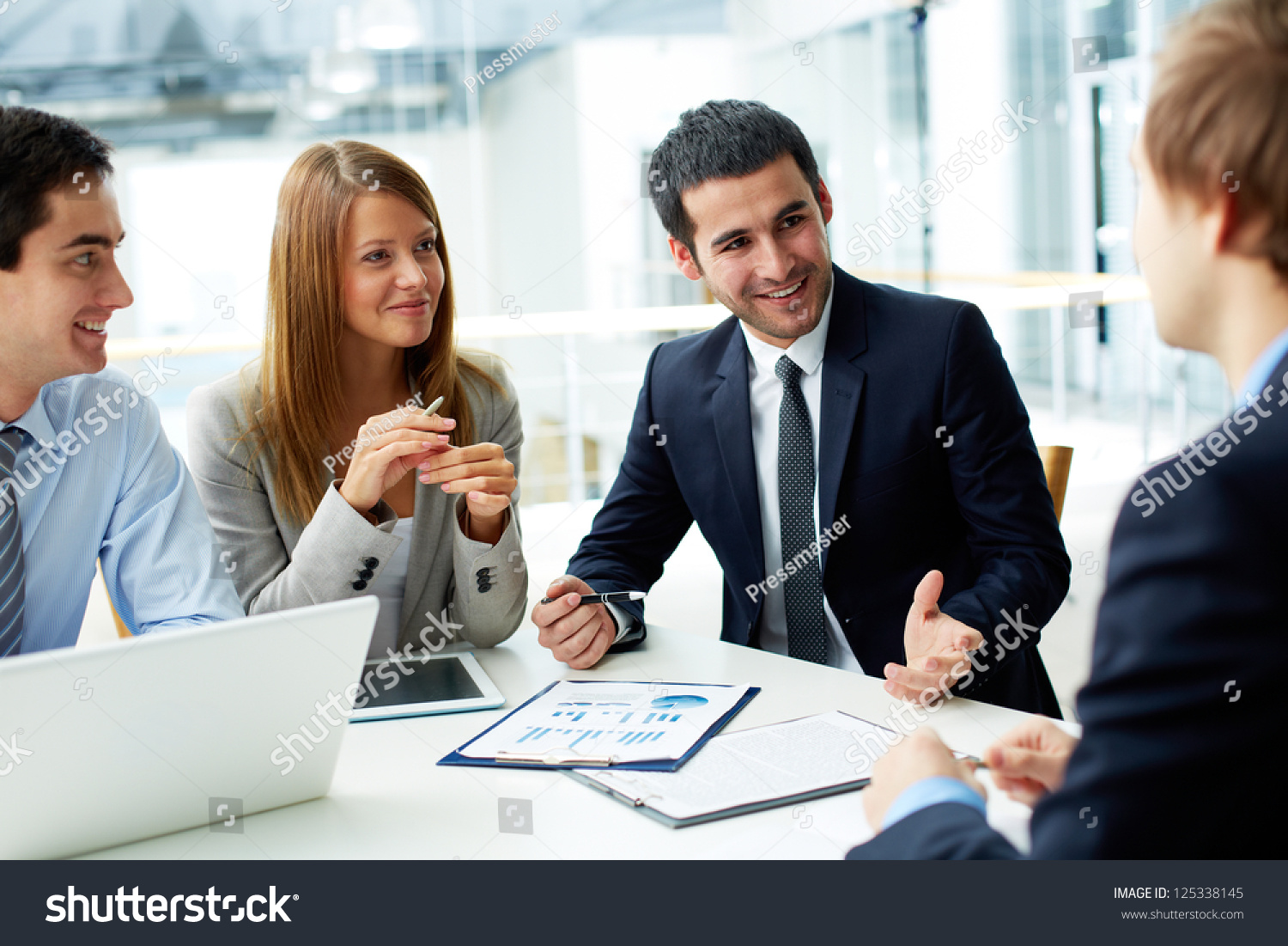 Image Business Partners Discussing Documents And Ideas #0: stock photo image of business partners discussing documents and ideas at meeting
