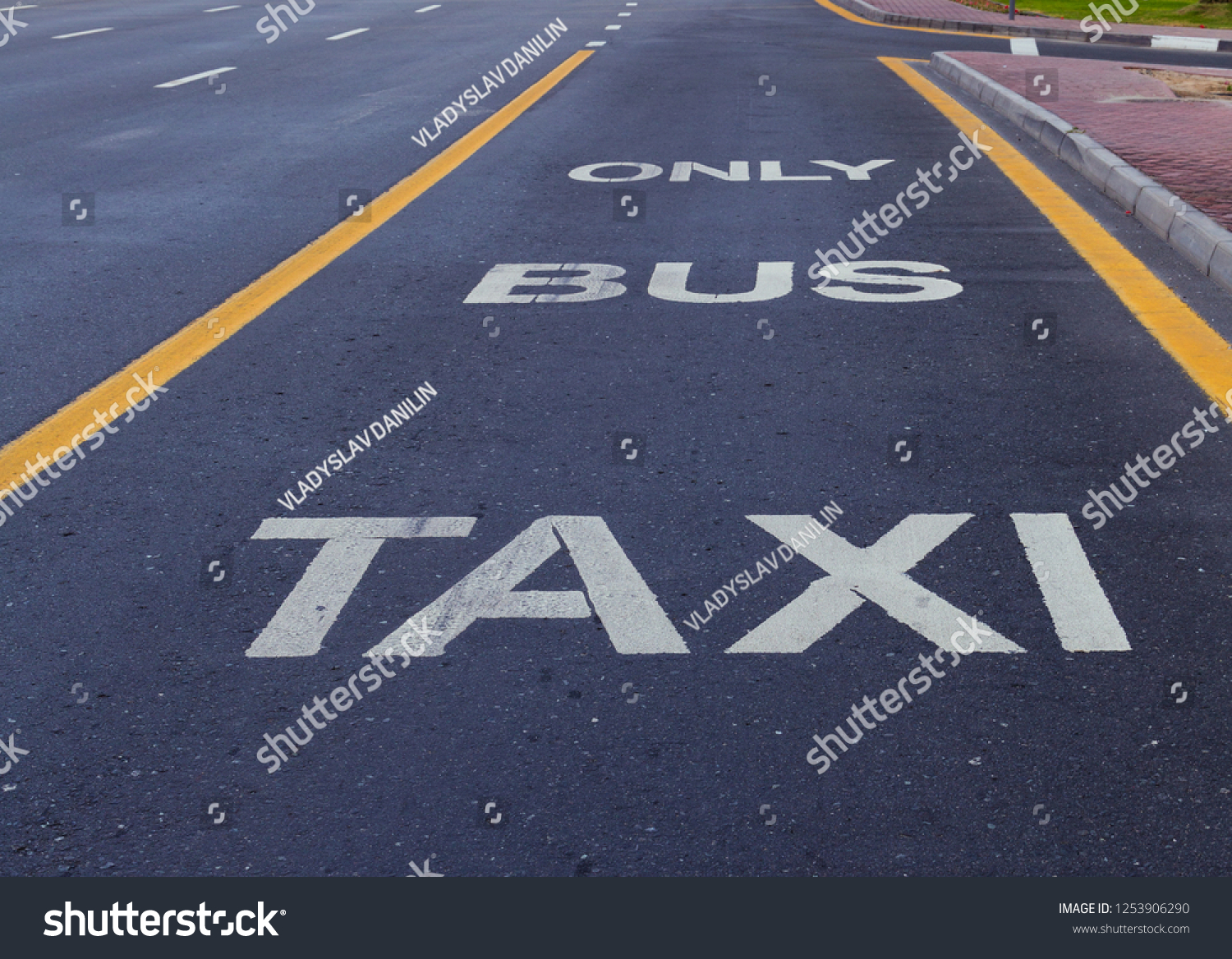 Bus and Taxi sign painted on street transport traffic #1253906290