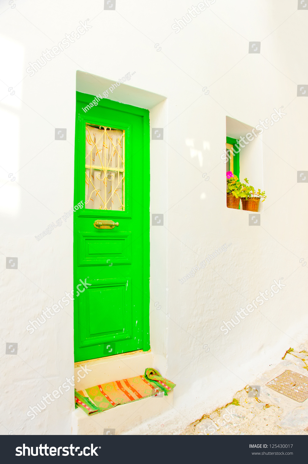 Old beautiful traditional house in chora the capital of amorgos island - A Beautiful Green Colored Wooden Door Of A Traditional Old House In Chora The Capital Of