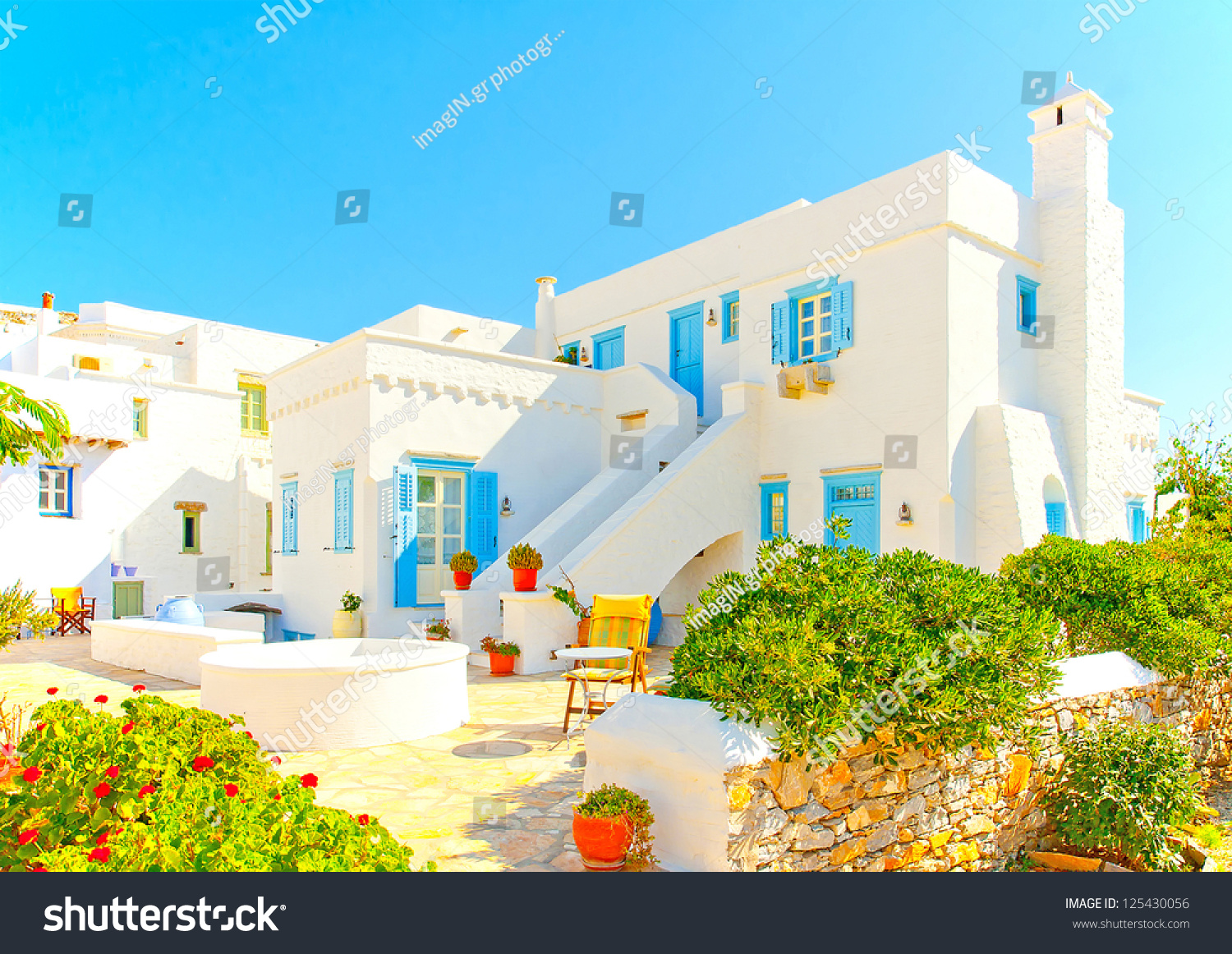 Old beautiful traditional house in chora the capital of amorgos island - Beautiful Complex Of Traditional Old Houses With Blue Colored Doors And Windows In Chora The Capital