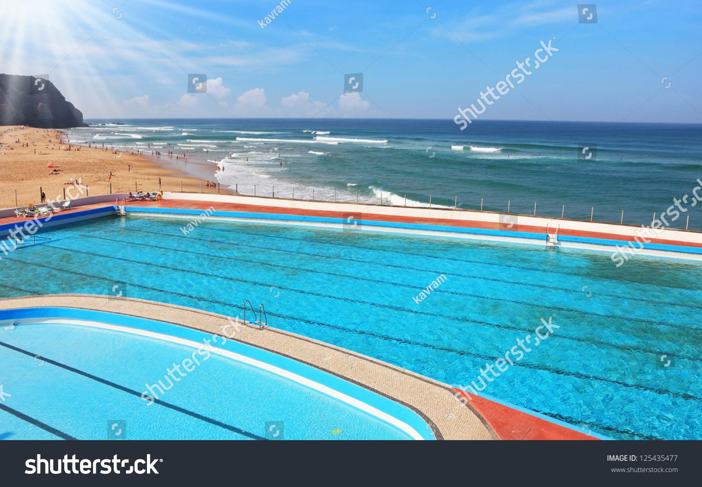 huge beautiful pool on beach atlantic stock photo. Black Bedroom Furniture Sets. Home Design Ideas