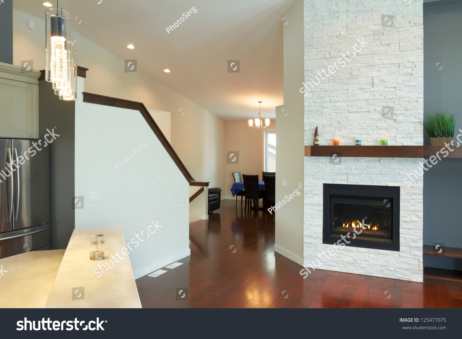 Interior design of modern Living room with fireplace in a new house #125477075