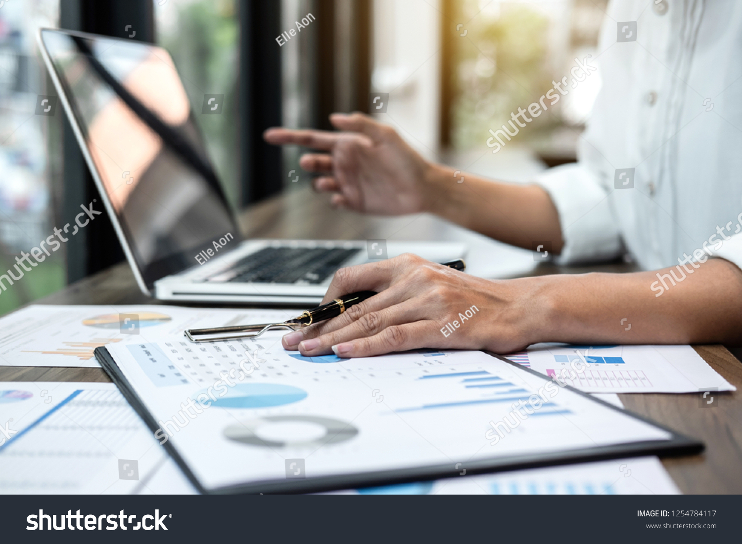 Business woman accountant working audit and calculating expense financial annual financial report balance sheet statement, doing finance making notes on paper checking document. #1254784117